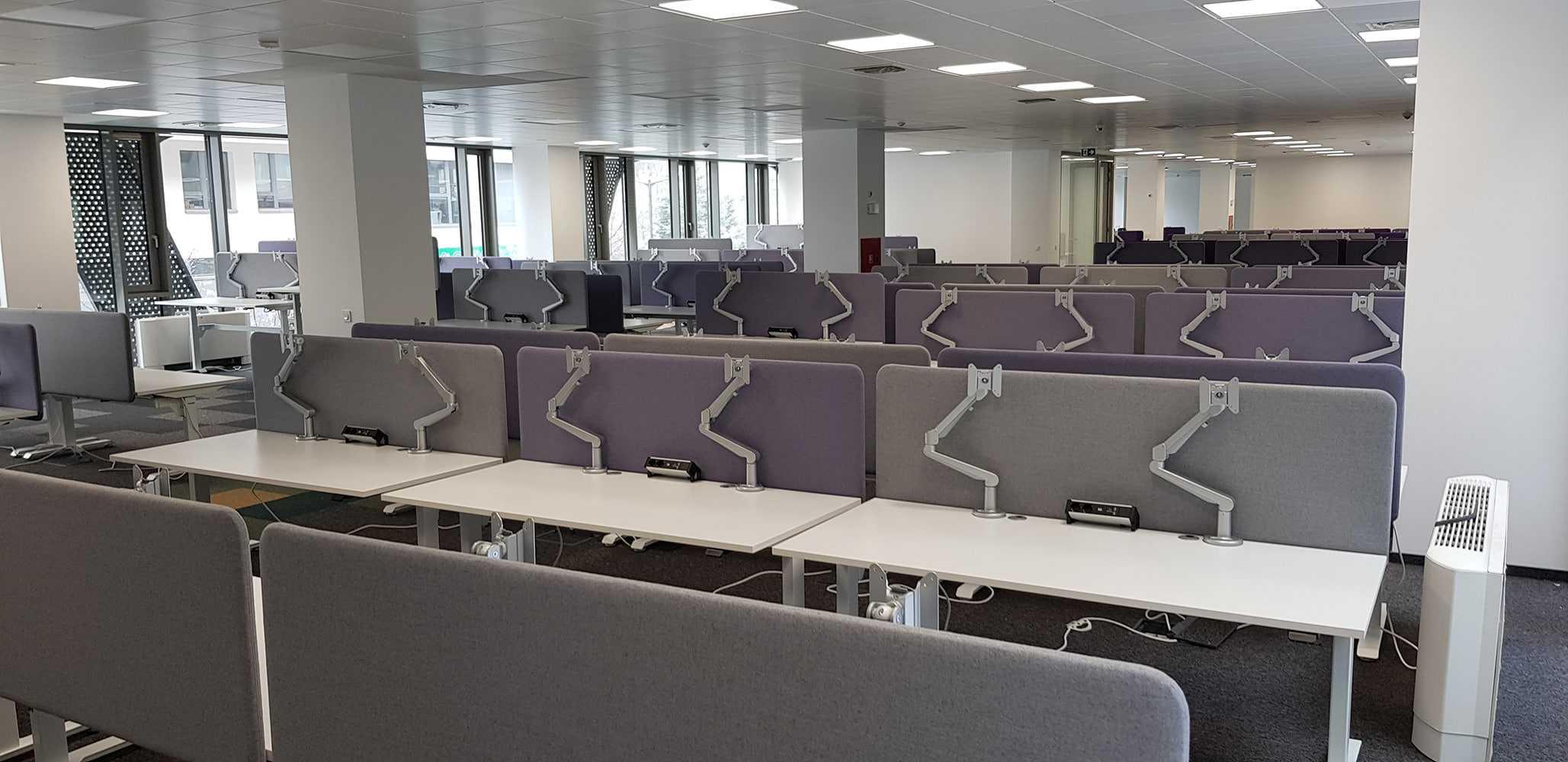 Modern office with sit-stand height adjustable desks BulDesk Pro