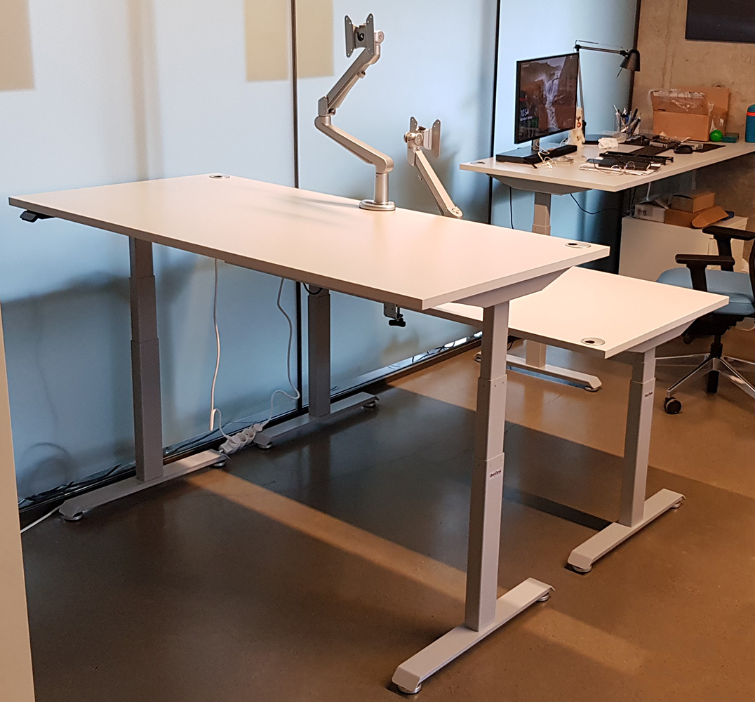 Grey desks BulDesk Pro for healthy office environment in Europe